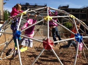 Students play outside in TNCS's playground after lunch.