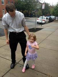 student and dad walk to school on International Walk to School Day