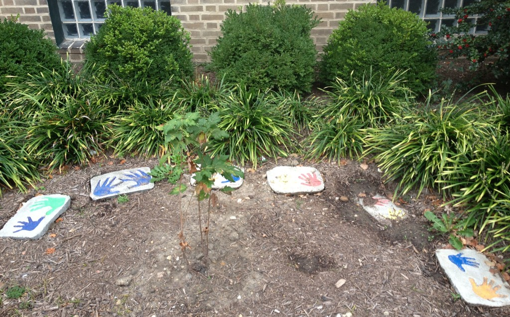 students pressed and painted hands for these stepping stones for TNCS front garden