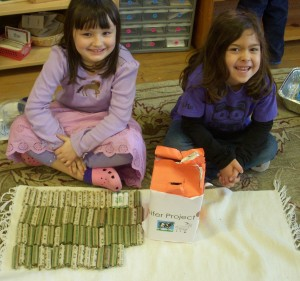 TNCS kindergartners proudly package their dimes to donate to Heifer International