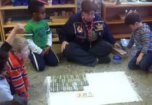 TNCS kindergartners have rolled and counted $385 worth of dimes to donate to Heifer International