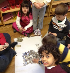 TNCS kindergartners all worked together to roll the thousands of dimes to donate to Heifer International