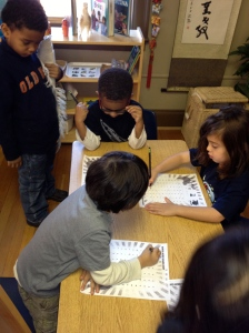 kindergartners collaborate on a math project for donating dimes to Heifer International