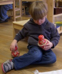 student works his way to the smallest doll, while strengthening hand muscles and learning persistence