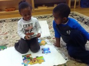 These primary students collaborate on a puzzle.