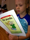 This elementary student reads a book in Spanish.