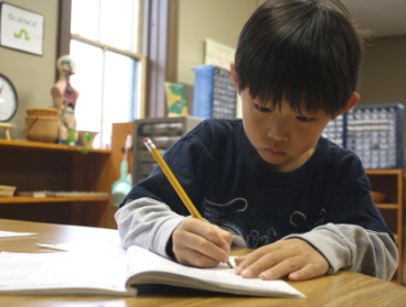 TNCS student practices writing in cursive.