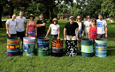 The proud artists pose with their work. Photo credit: Brian Schneider, www.ebrianschneider.com