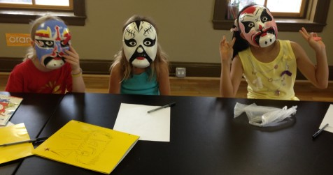 The girls model their beautiful Chinese masks.