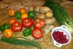 A lovely profusion of red and yellow tomatoes, green peppers, potatoes, fennel, garlic, chives, and---oh yeah---raspberries!