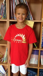 Wearing her TNCS shirt, Grace represents the school beautifully!