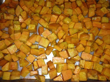 Peeled, roasted sweet potatoes go into freezer bags for later use in other recipes.