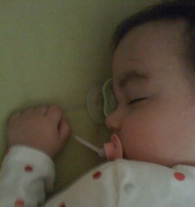 We all have our sleep triggers. This baby girl gets to sleep with--and on--a pacifier.