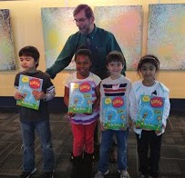 "The proud recipients of their new books pose with Councilman Kraft. If the Lorax ""speaks for the trees,"" Councilman Kraft sure speaks the same language!"