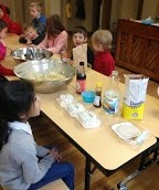 The elementary students patiently await dumpling-making instructions.