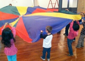 Kids are engaged in group games and collaborative play during Date Night fun!