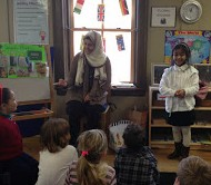 Mom and daughter present their native country to the rest of the class.