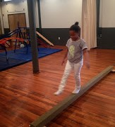 Balancing and walking on the beam hones coordination.