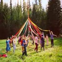 Decorating the maypole to herald Spring.