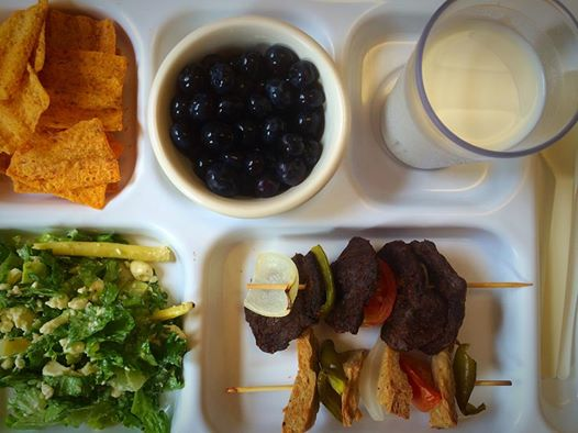 Faux chicken and beef kebabs with local onions, peppers, and tomatoes; local lettuce, wax bean, cucumber and feta salad; sun chips; and local blueberries. Washed down with milk.