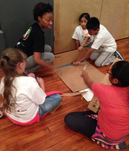 Miss Fanta guides a team in constructing their pinbug machine.