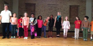 The class lines up to take a group bow after their hard work during rehearsal. Well done kids!