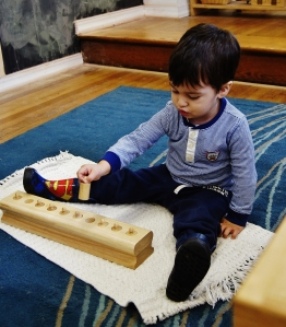 tiny-TNCS-tot-explores-multiple-dimensions-with-Graduated-Cylinder-Blocks